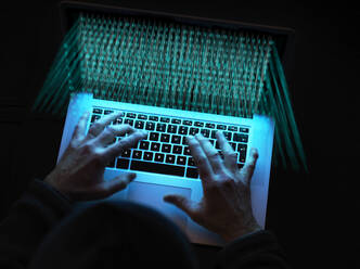 Cyber crime, A hacker using a virus to attack software - ABRF00635