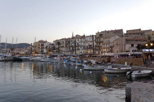 Boats moored at Port of Calvi during sunset, Corsica, France - ZCF00795