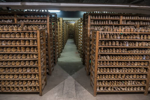 Wooden shoes arranged on shelves in Fagus Factory, Lower Saxony, Germany - RUN02900