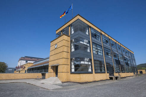 Low angle view of Fagus Factory against clear blue sky at Alfeld, Lower Saxony, Germany - RUN02903