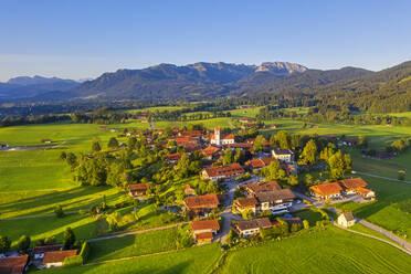 Aerial view of buildings at Wackersberg with Brauneck and Benediktenwand in background, Isarwinkel, Upper Bavaria, Bavaria, Germany - SIEF08988