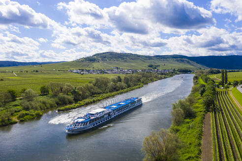 Aerial view of cruise ship on Mosel River amidst land against cloudy sky, Germany - RUNF02929