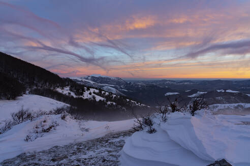 Scenic view of snow covered mountains against sky during sunrise, Umbria, Italy - LOMF00903