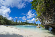 Scenic view of white sand beach against sky, Ile Des Pins, New Caledonia - RUNF02951