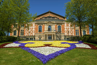 Colorful flowers in front of Bayreuth Festspielhaus during sunny day, Bayreuth, Germany - LBF02706