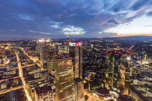 Cityscape against cloudy sky at night, Frankfurt, Hesse, Germany - WDF05500