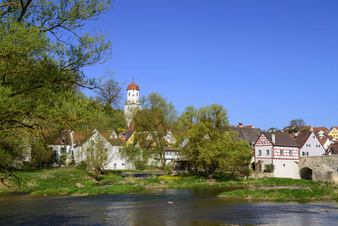St. Barbara church by river against clear blue sky in town, Harburg, Germany - LBF02710