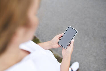 Close-up of woman using smartphone outdoors - BSZF01447