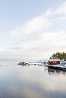 Boat shed in snow by river - FOLF10840