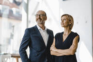 Portrait of confident businessman and woman - KNSF06347