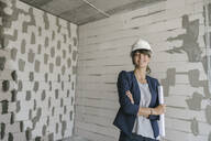 Portrait of female architect on construction site - AHSF00815