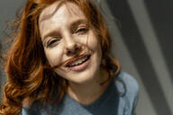 Portrait of smiling redheaded woman - KNSF06457