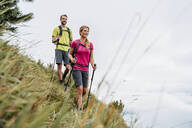Confident young couple on a hiking trip in the mountains, Herzogstand, Bavaria, Germany - DIGF08282