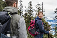 Young couple on a hiking trip in the mountains, Herzogstand, Bavaria, Germany - DIGF08318