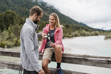 Young couple having a break during a hiking trip, Vorderriss, Bavaria, Germany - DIGF08357