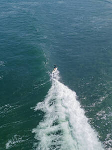 Aerial view of female surfer, Bali, Indonesia - KNTF03383