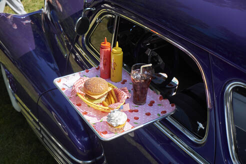 Typical American fast food on tray at vintage car, Chevrolet Fleetline - BSCF00609