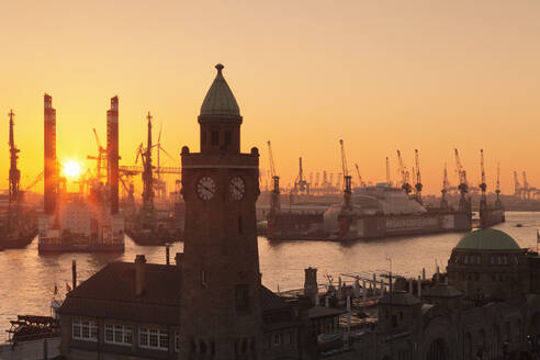 St. Pauli Landungsbruecken pier against harbour at sunset, Hamburg, Hanseatic City, Germany, Europe - RHPLF08787
