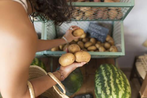 Ciutadella de Menorca, Baleares, Spain. Young woman in organic store - JPTF00290