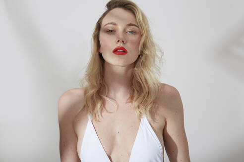 Portrait of young blond woman with red lips - PGCF00018