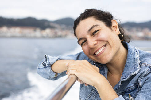 Beautiful woman smiling during a ship trip in Galicia, Spain - ABZF02589