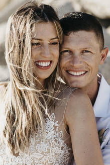 Portrait of happy bride and groom outdoors - LHPF00802