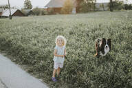 Girl going walkies with dog in the countryside - DWF00493