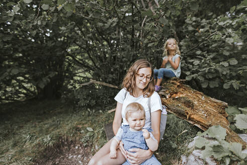 Mother with two daughters in a forest - DWF00505