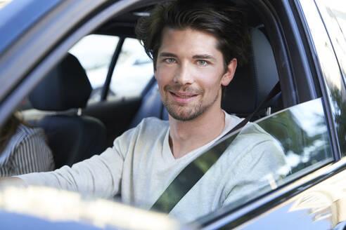 Portrait of confident man driving car - PNEF01985