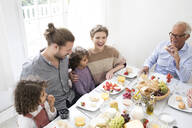 Happy extended family having lunch at home - MJFKF00022