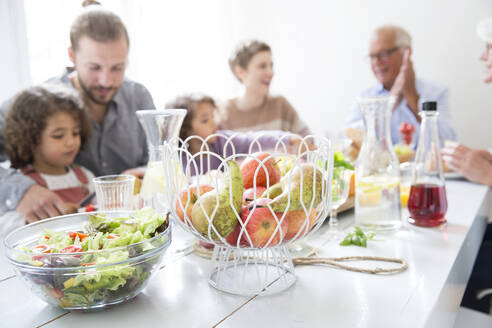 Extended family having healthy lunch at home - MJFKF00118