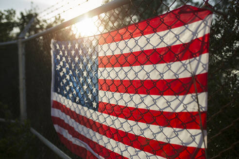 US-American flag on barbed wire fence, close up - JPTF00319