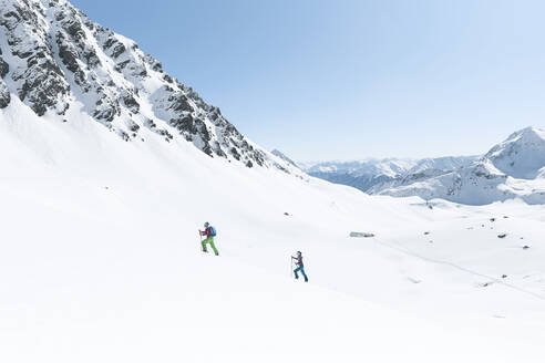 Couple ski touring in the mountains, Kuehtai, Tyrol, Austria - CVF01497