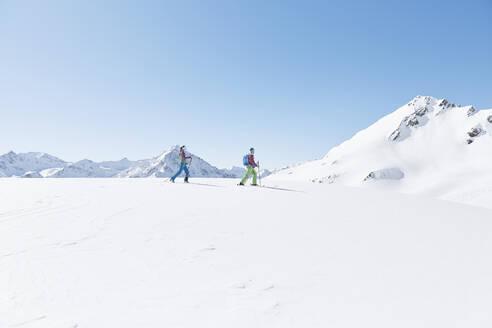 Couple ski touring in the mountains, Kuehtai, Tyrol, Austria - CVF01500