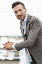 Portrait of confident businessman in the city - DIGF08416