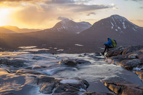 Hiking in the Scottish Highlands in Torridon along The Cape Wrath Trail near Loch Coire Mhic Fhearchair, Highlands, Scotland, United Kingdom, Europe - RHPLF09260