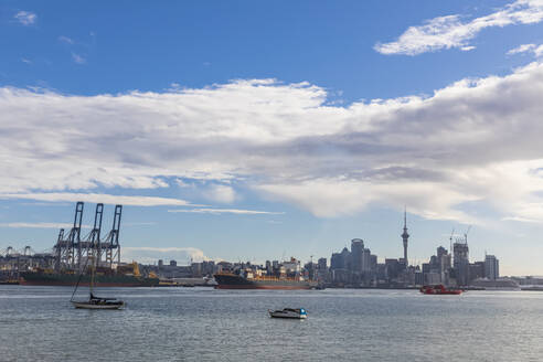 Modern buildings and Devonport by sea against cloudy sky in Auckland, New Zealand - FOF10897