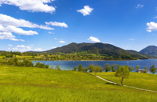 Scenic view of Lake Tegernsee and mountains against blue sky, Bavaria, Germany - LHF00693