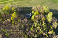 Aerial view of Chapel St. Georg amidst trees, Ascholding, Germany - LHF00696