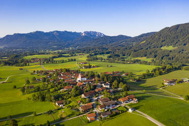 Aerial view of town and mountains against clear sky, Bad Toelz-Wolfratshausen, Germany - LHF00708