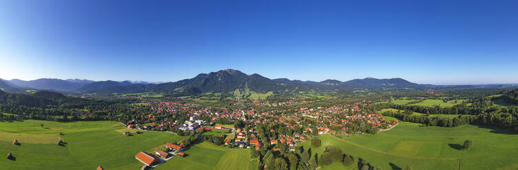 Drone shot of Lenggries with Brauneck against clear blue sky, Bavaria, Germany - LHF00711