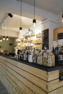Assortment of breakfast cereals on counter in a cafe - GIOF07143