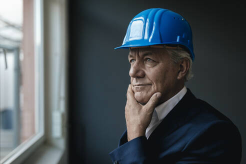 Portrait of a confident senior businessman wearing hard hat - GUSF02598