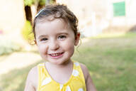 Portrait of a smiling little girl outdoors in summer - GEMF03146