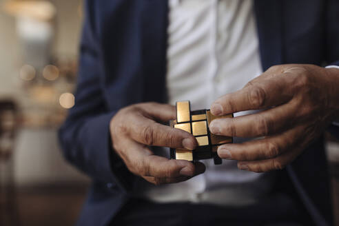 Close-up of businessman with Rubik's Cube - GUSF02648