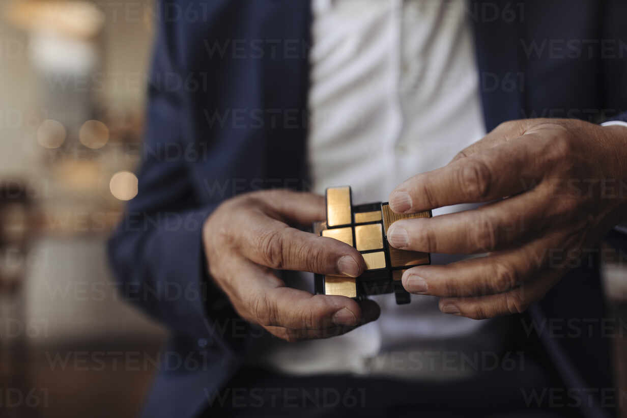 Close-up of businessman with Rubik's Cube - GUSF02648 - Gustafsson/Westend61