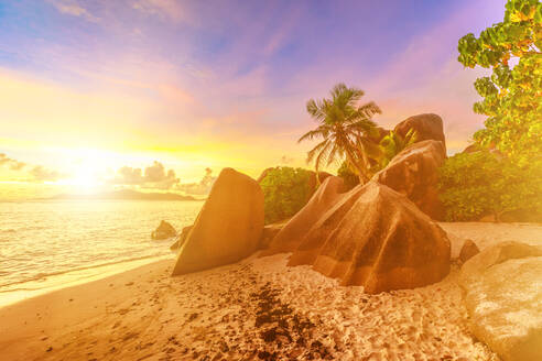 Rocks on beach and palm trees, Anse Source d'Argent at sunset, La Digue, Seychelles, Indian Ocean, Africa - RHPLF10309