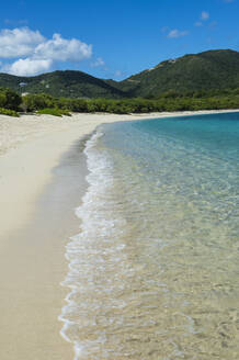 Scenic view of Long bay beach against blue sky during sunny day, Beef island, British Virgin Islands - RUNF03144