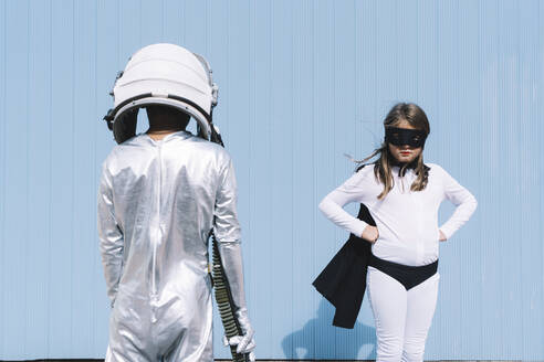 Two kids in astronaut and superhero costumes - DAMF00046