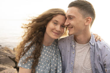 Portrait of young couple at the beach - VPIF01511